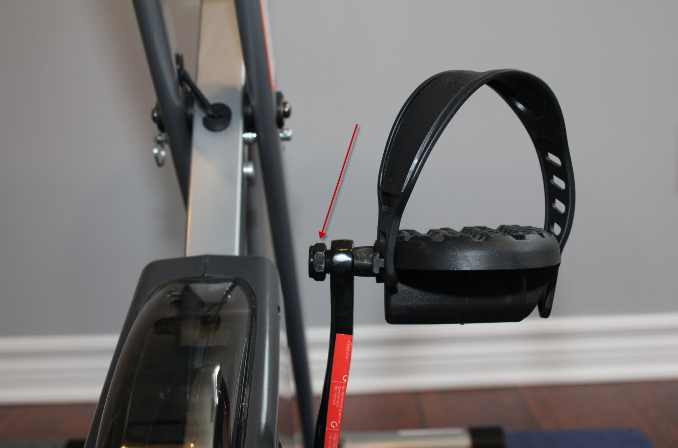 Pedal with strap and nut